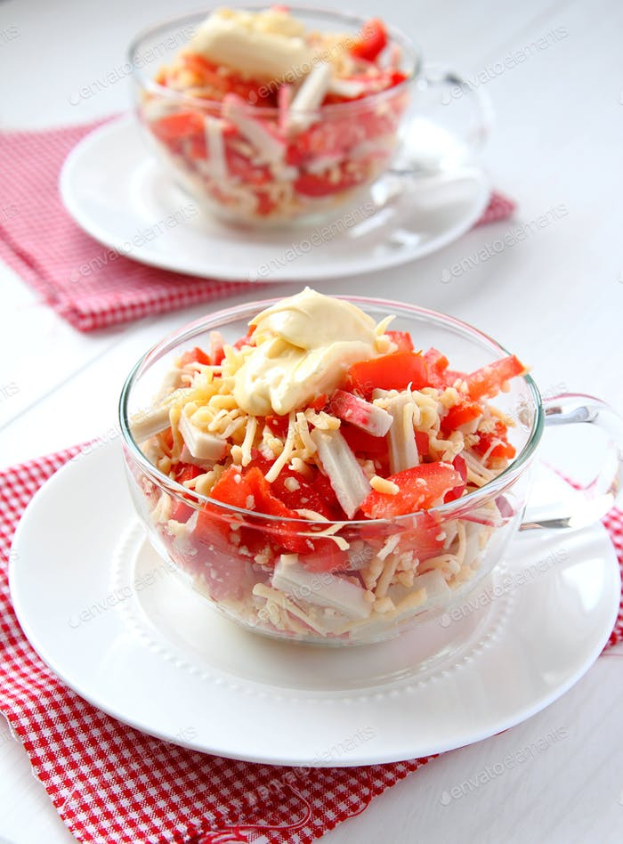 Crab salad with tomatoes, peppers and cheese