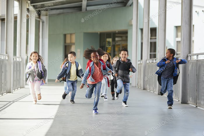 Elementary school kids running in a corridor in the school