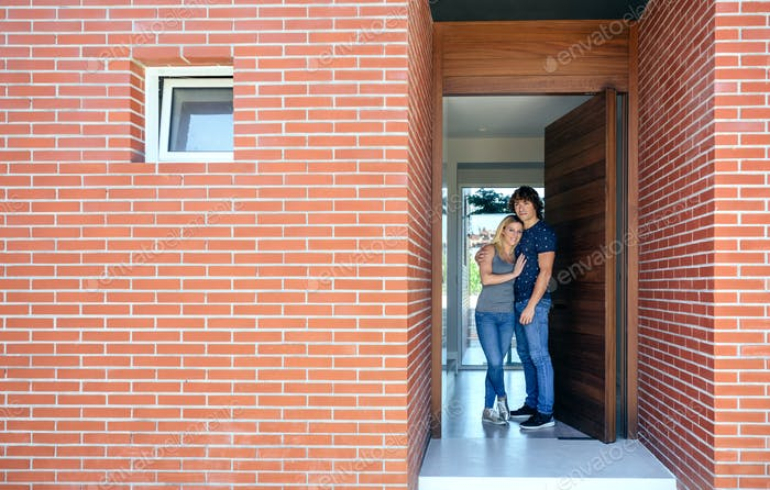 Couple at the entrance of their house