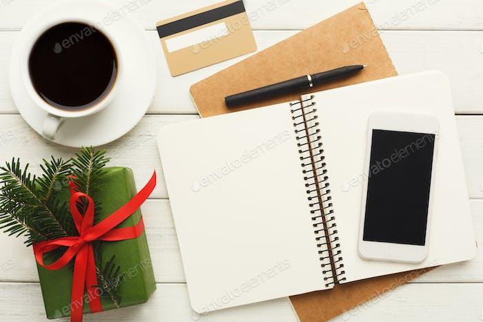 Christmas wish list on wood table background
