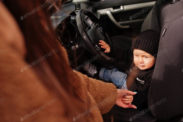 Young mother and child in car. Safety driving concept.