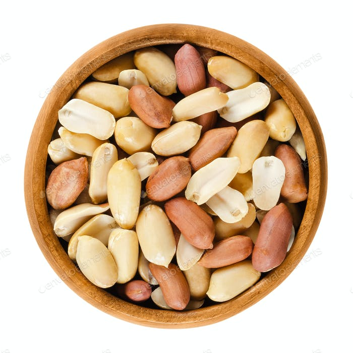 Shelled peanuts in wooden bowl over white