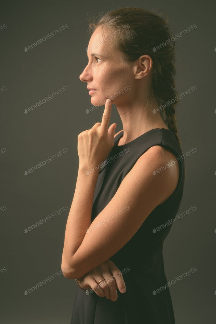Studio shot of beautiful woman against gray background