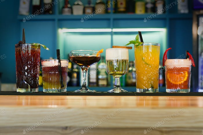 Creative alcohol cocktails in night club bar