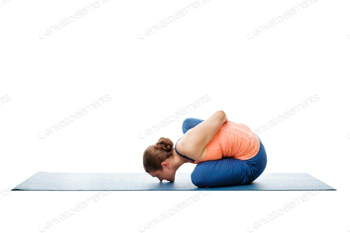 Woman doing Ashtanga Vinyasa Yoga asana Marichyasana B