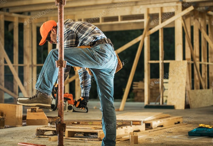 Construction Contractor with Chainsaw Preparing Wood Elements