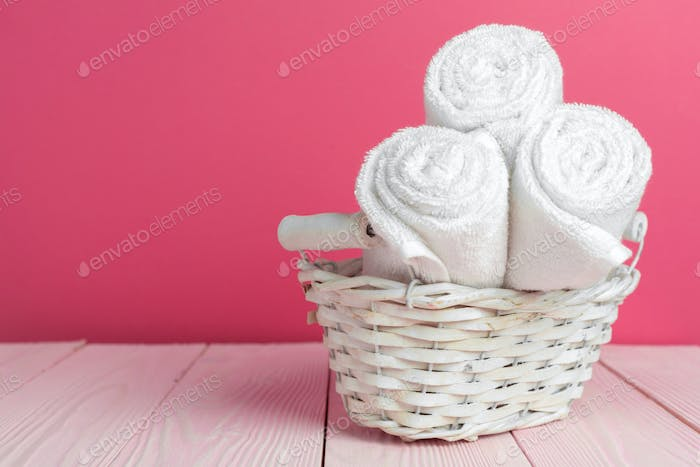 Clean soft towels on wooden table. Close up