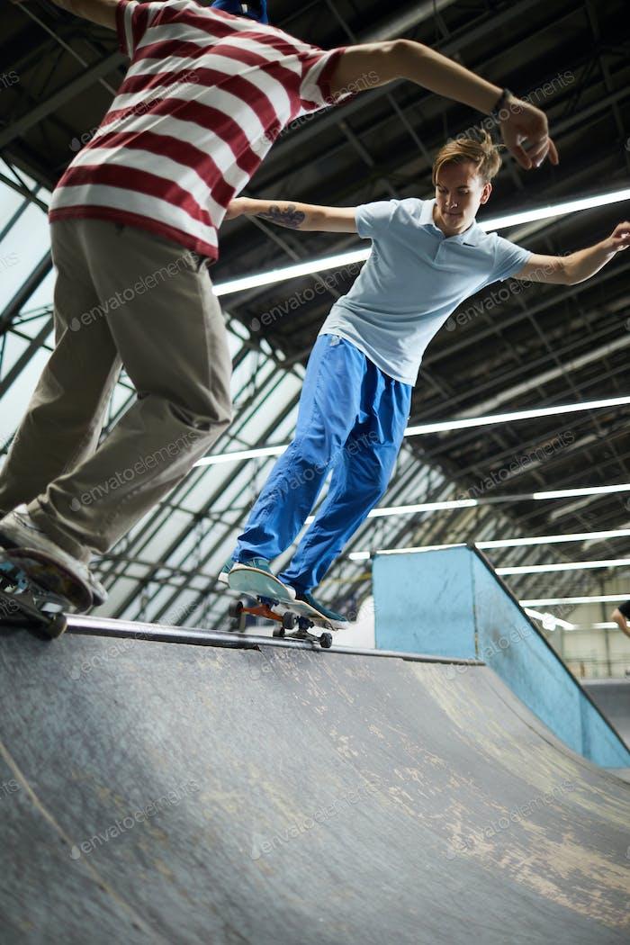 Skateboarding at parkour center