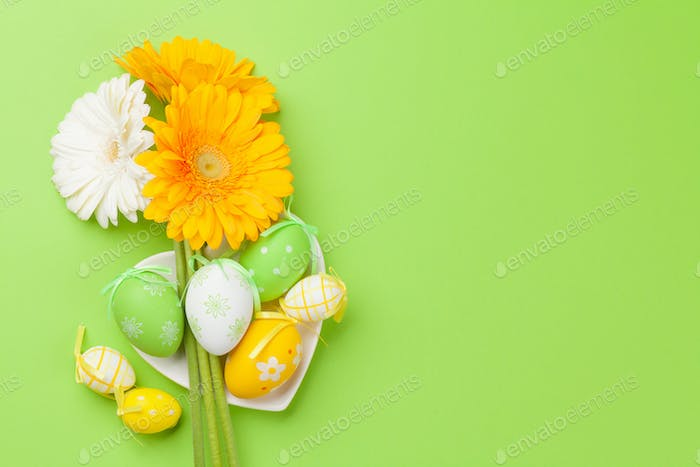 Easter greeting card with flowers and easter eggs