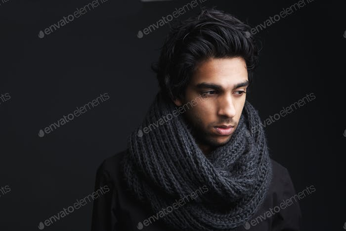 Attractive young man in wool scarf