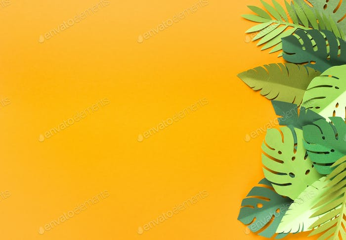 Piece of jungles on yellow summer background with free space