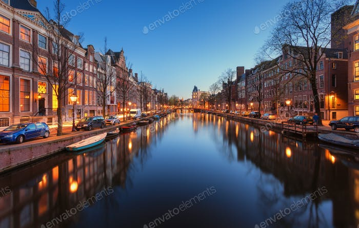 Beautiful night cityscape with canals of Amsterdam, Netherlands