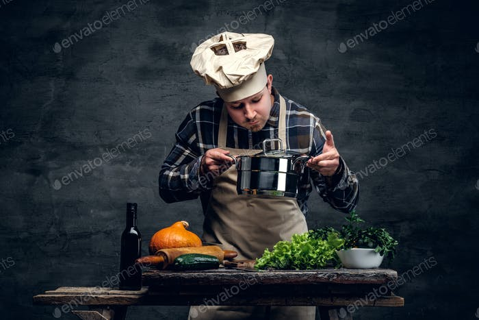 A man cooking a soup and tasting it.