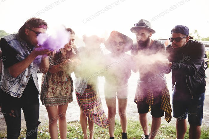 Friends blowing the holi colors at festival