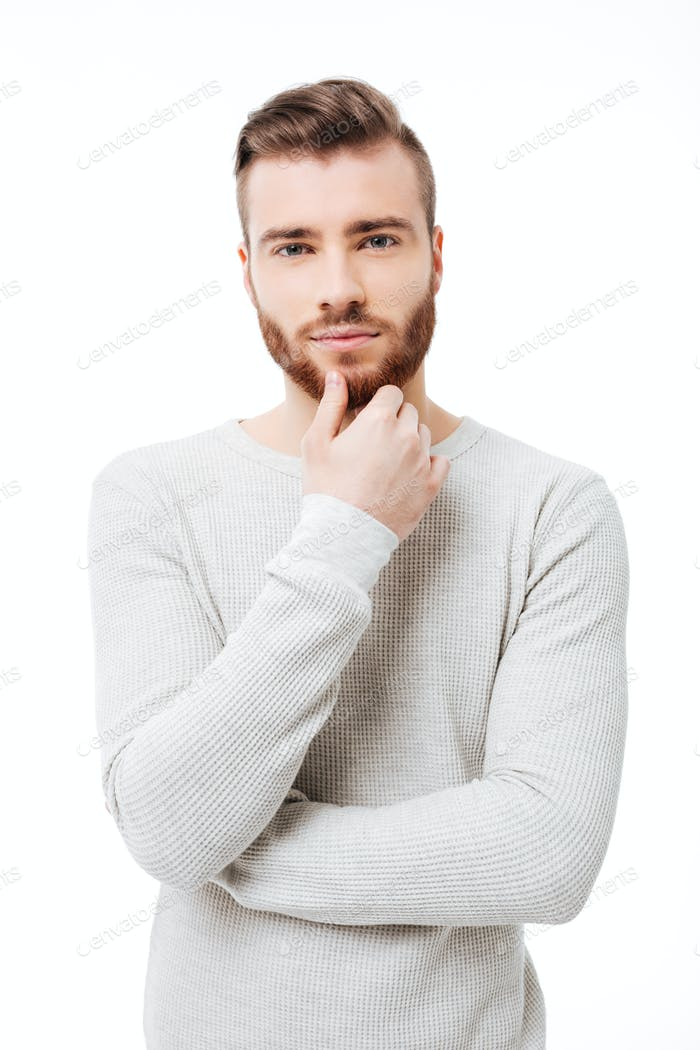 Vertical portrait of young handsome man looking at  the camera over white background