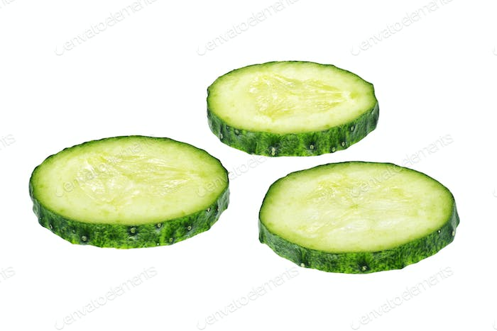 Fresh cucumber slices isolated