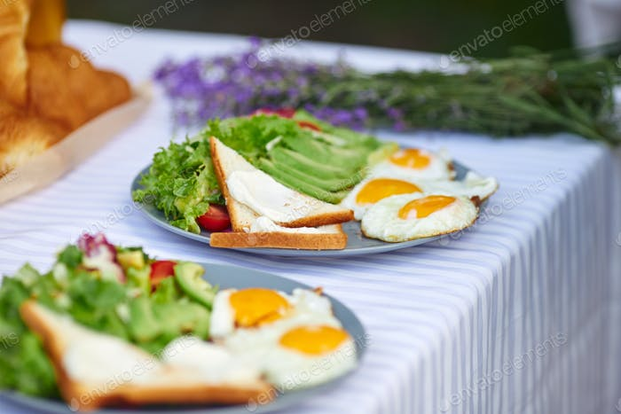 Food served for two on table outdoors