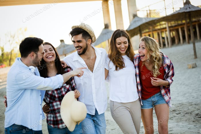 Group of happy young people enjoying summer vacation