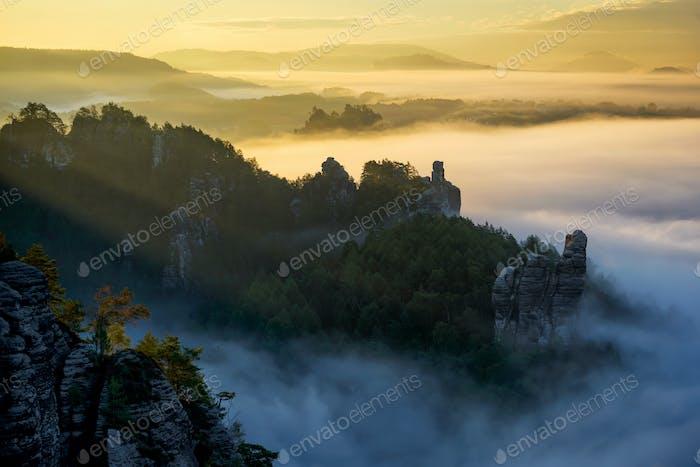Foggy sunrise at Bastei, Saxon Switzerland, Germany. Typical saxony autumn landscape.