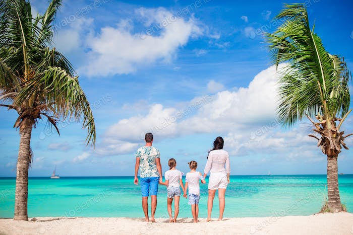 Family of four on the beach on caribbean vacation