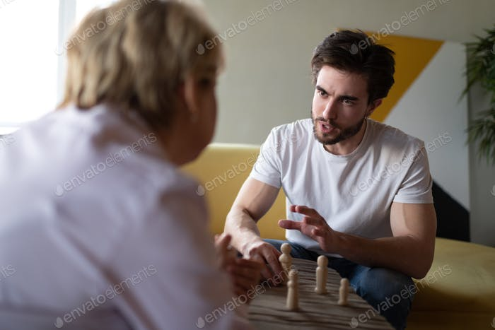 Angry man talking to psychologist