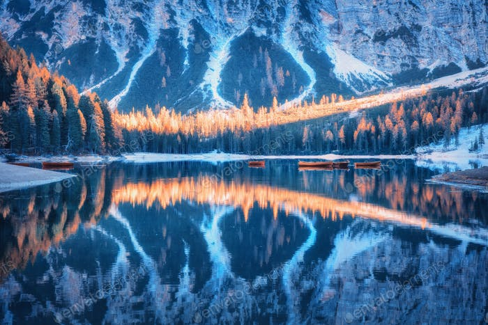 Lake with beautiful reflection in water at sunrise in autumn
