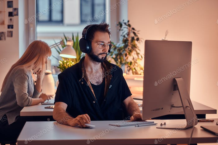 Man and woman are working in the office