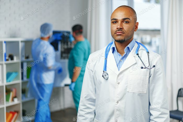 Portrait of african american doctor, hospital background