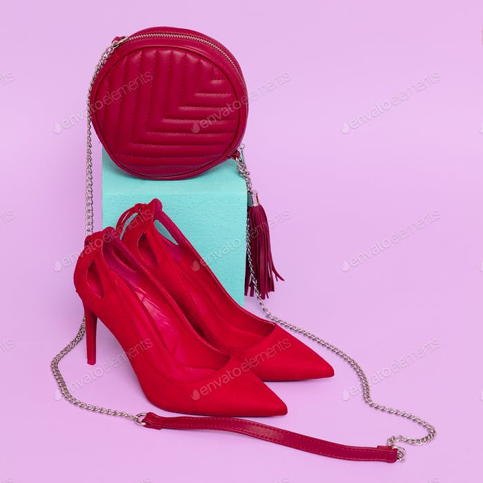 Red Lady shoes and clutch. Minimal stylish concept