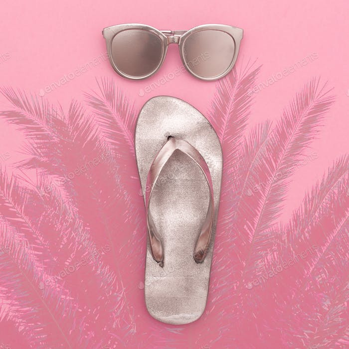 Silver set vacation. Flip-flops and sunglasses, beach fashion st