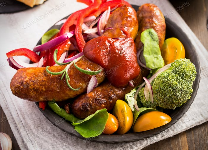 Homemade sausage with vegetables and ketchup