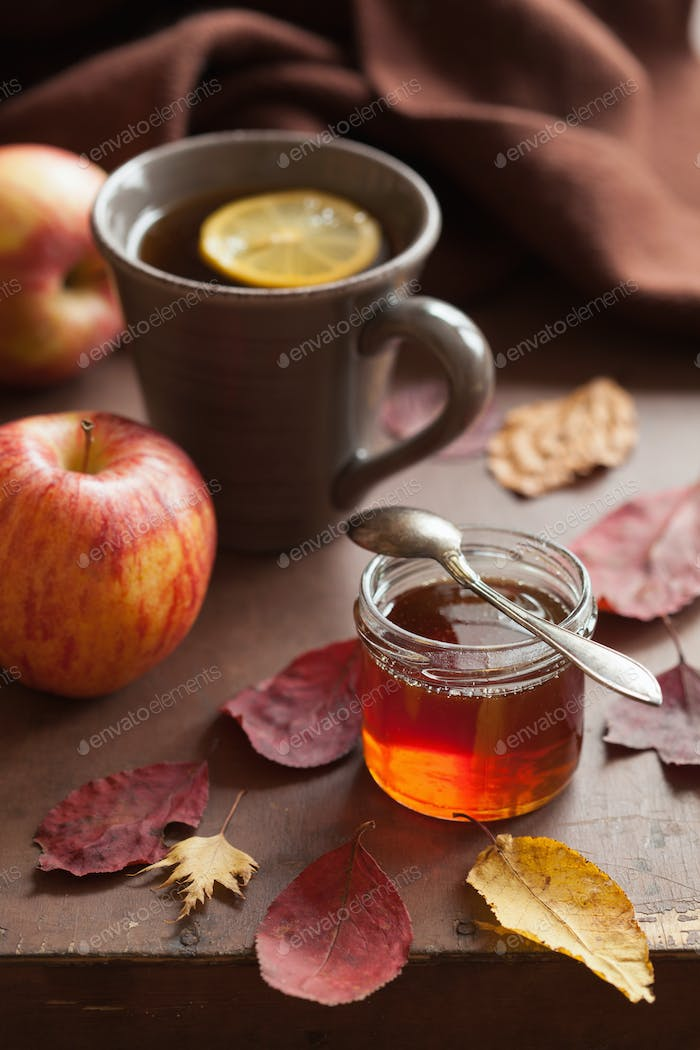 hot lemon honey tea warming drink scarf cozy autumn leaves