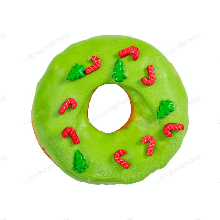 Christmas donut with green icing and sprinkles isolated on white