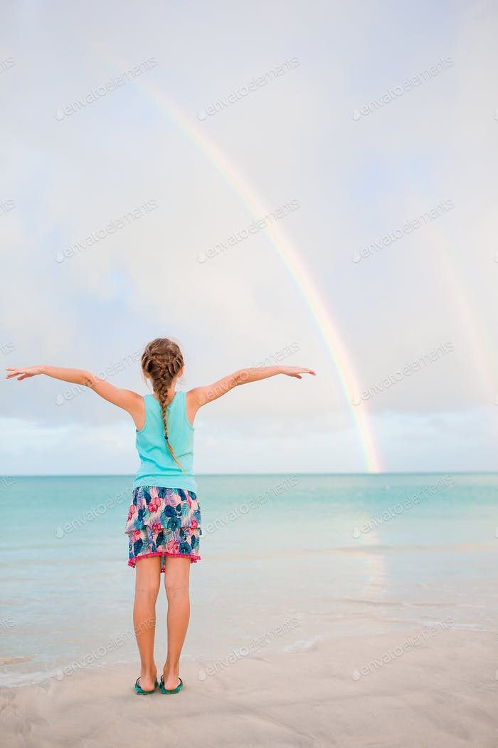 Adorable little girl on the beach. Happy girl enjoy summer vacation background the blue sky and