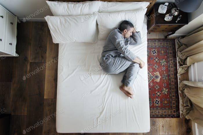 French man sleep alone on bed