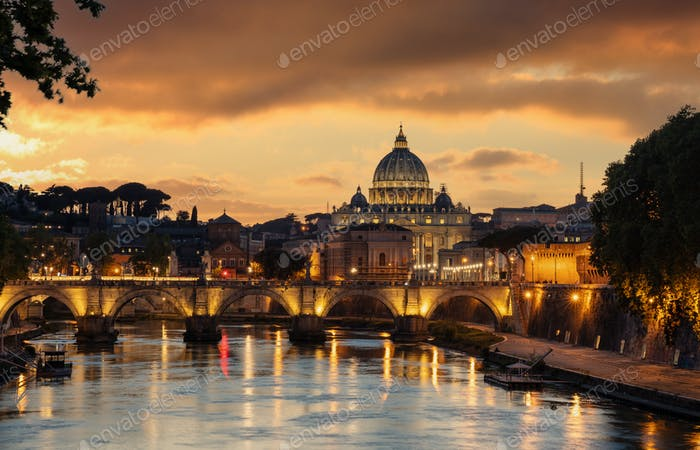 Rome Italy. San Pietro basilica in the Vatican, ponte Sant Angelo and Tiber river, sky at sunset