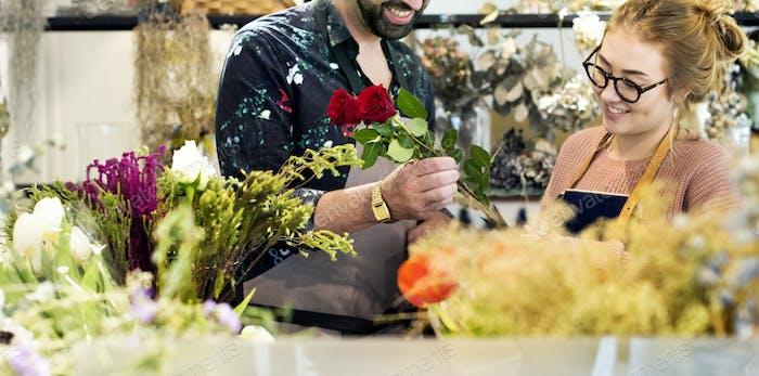 Florists making flower bouquet together