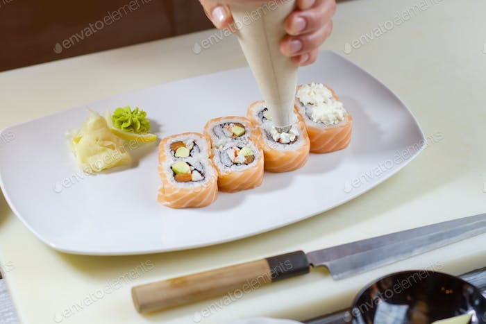 Pastry bag over sushi rolls