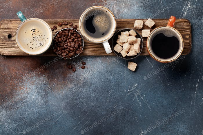 Coffee cups, beans and brown sugar