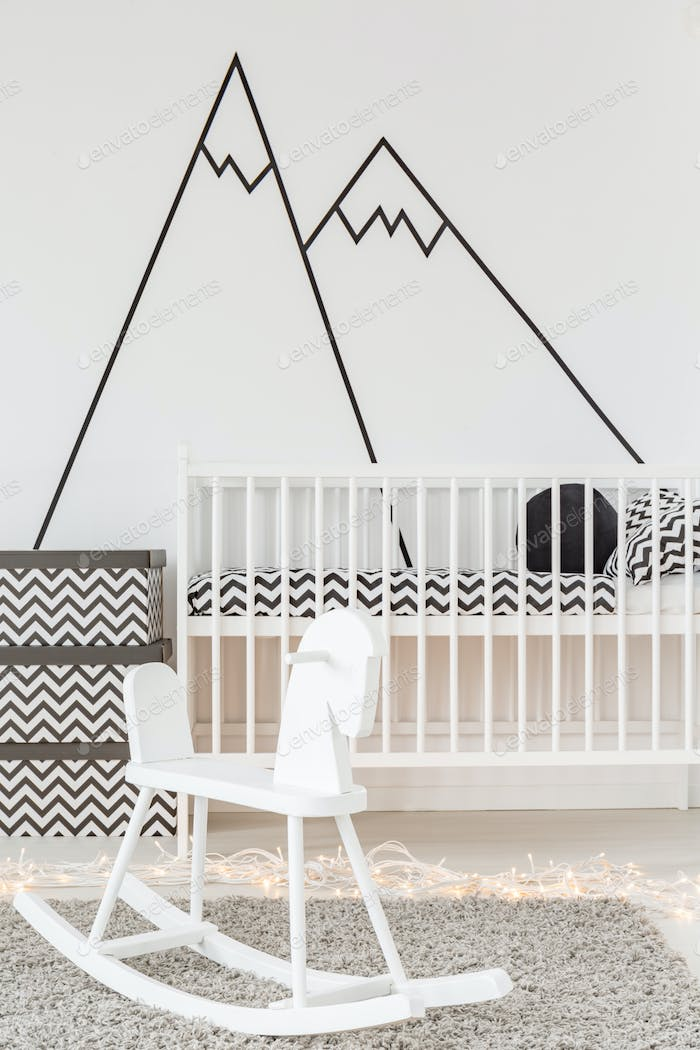 Room with white cot