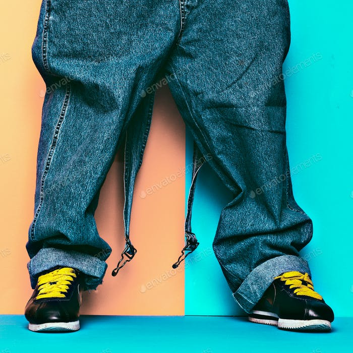 Stylish Jumpsuit. Urban Style. Sneakers and denim