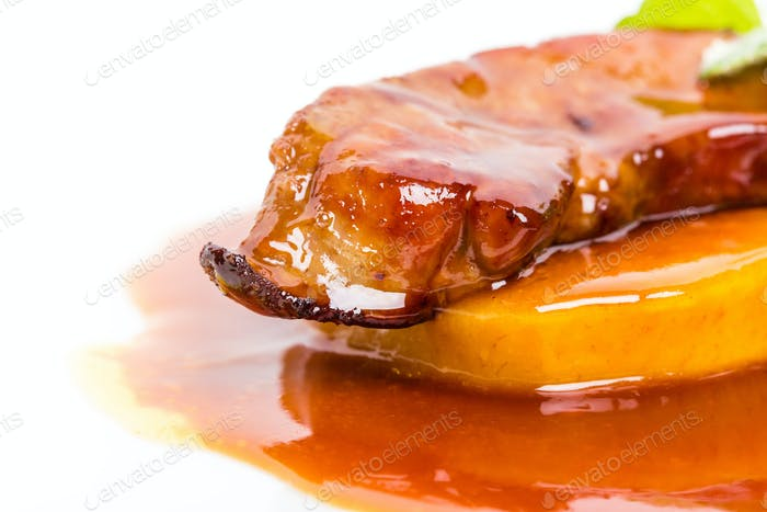 Delicious goose foie gras on baked pears.
