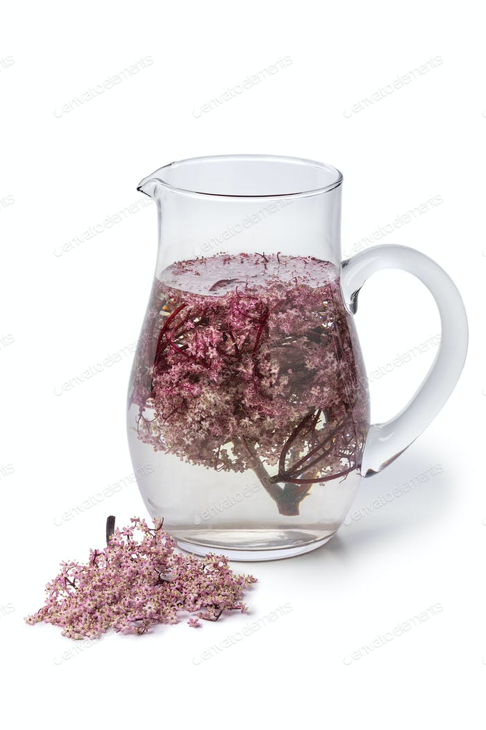 Glass can with cold pink elderberry blossom drink