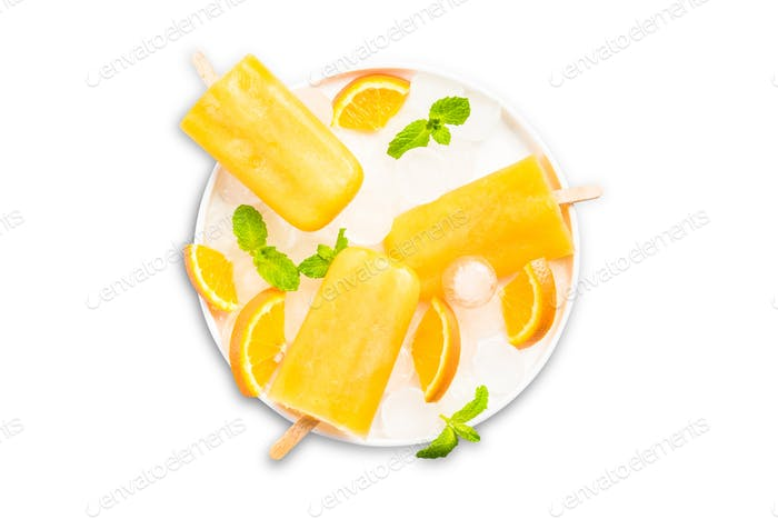Orange juice homemade popsicles, isolated on white