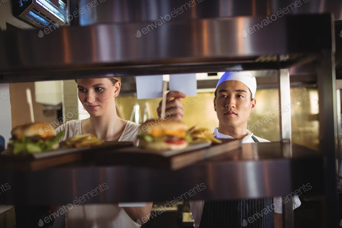 Chef looking at an order list in the commercial kitchen