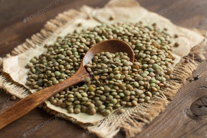 Green lentils with a spoon