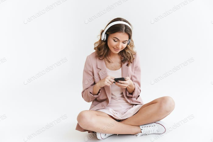 Young cute beautiful woman listening music