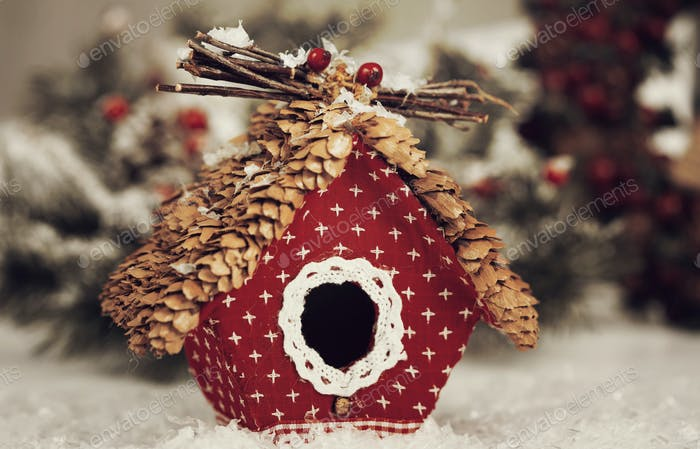Christmas greeting card with small birdhouse