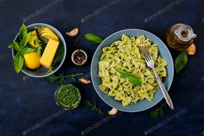 Vegan  Farfalle pasta in a basil-spinach sauce with garlic. Flat lay. Top view