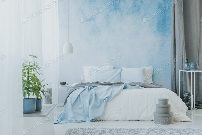 Bed on ombre wall
